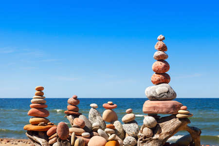 many of the Rock zen pyramid of white and pink pebbles on the beach. Concept of balance, harmony and meditation