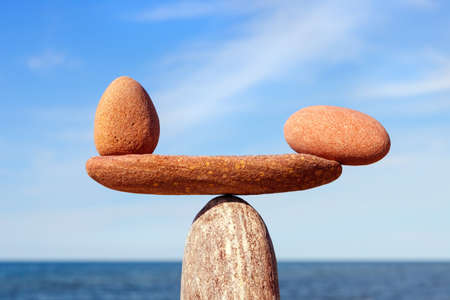 Photo for Symbolic scale of the stones on sea background closeup. Concept of harmony and balance. work-life, emotional balance - Royalty Free Image