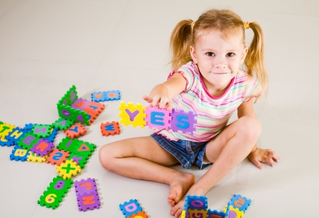 Photo for little girl shows the word  - Royalty Free Image