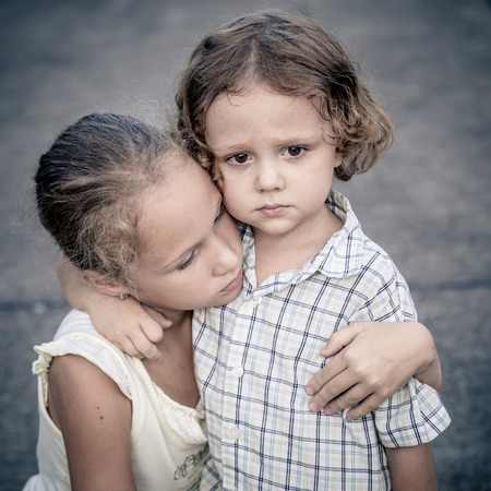 Photo for Portrait of sad teen girl and little boy at the day time - Royalty Free Image