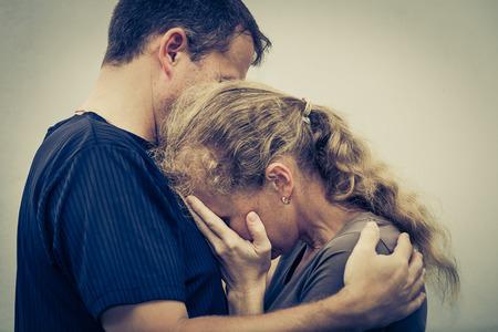 Photo for Sad woman hugging her husband - Royalty Free Image