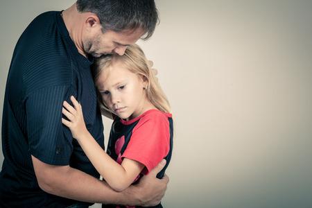 Photo pour portrait of one sad daughter hugging her father - image libre de droit