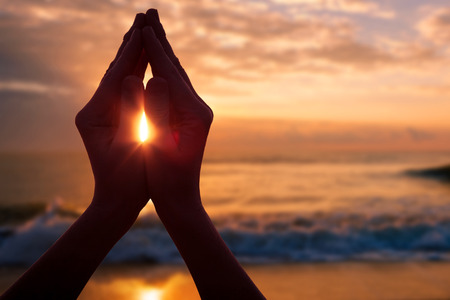 Photo pour silhouette of female hands during sunset. Concept of life - image libre de droit