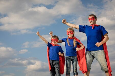 Photo pour Father and children playing superhero at the day time. People having fun outdoors. Concept of friendly family. - image libre de droit
