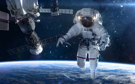 Photo for Astronaut, space station in deep space. Beautiful cosmic landscape. Science fiction. Elements of this image furnished by NASA - Royalty Free Image