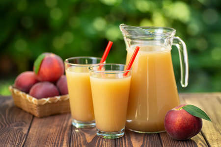 Photo for peach juice in glasses and jug - Royalty Free Image