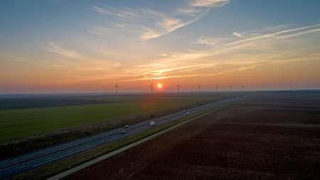 Photo pour Wind turbines along the highway at sunset, France - image libre de droit