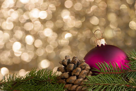Christmas decoration on spruce, pine cones and ball