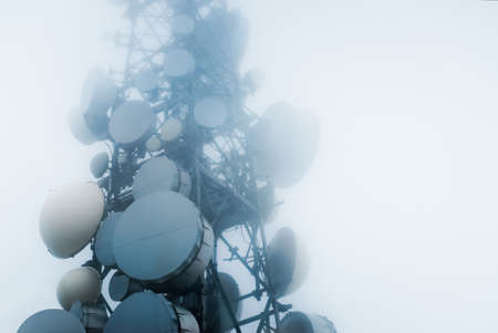 telecommunications tower into the clouds
