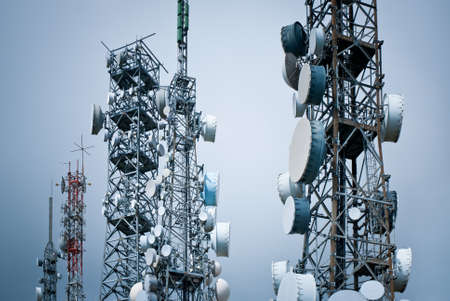 telecommunications towers against a gray sky