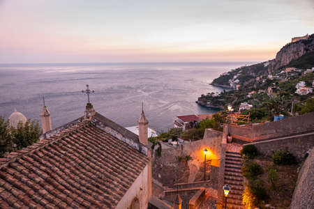 Foto per Amalfi, Italy. September 4th, 2020. Enchanting view at sunset on the Amalfi Coast near Amalfi. On the left in the foreground the Church of Santa Maria Bambini. - Immagine Royalty Free