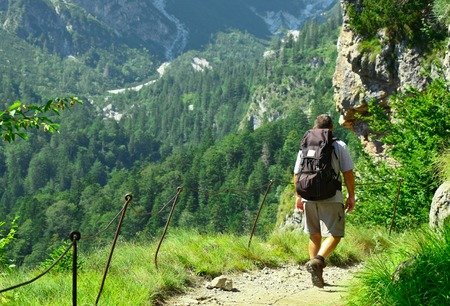 traveller adult men clime up on dolomites Alps in Italy