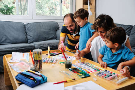 Photo for a family painting and playing with their kids - Royalty Free Image