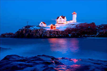 Cape Neddick (Nubble) Light is lit during the holiday season and in the festival of lights six months later in July.