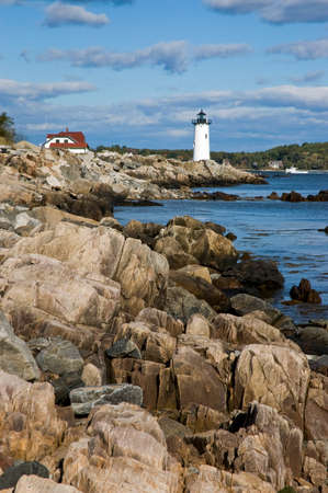 Portsmouth Lighthouse guides mariners away from the rocky shoreline.