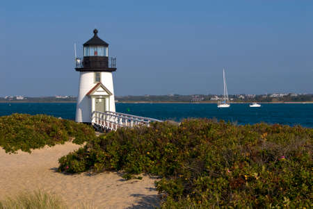 Brant Point Lighthouse guides boaters in the Harbor of Oak Bluffs on Nantucket Island.