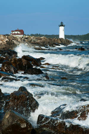 During high tide waves crash against the rocky shoreline by Portsmouth Harbor lighthouse, also referred to as Fort Constitution light, as the area is the site of the beginning of the American Revolution.