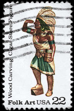 USA - CIRCA 1986: A Stamp printed in USA shows the Cigar Store Figure from the series American Folk Art, Wood Carving, circa 1986