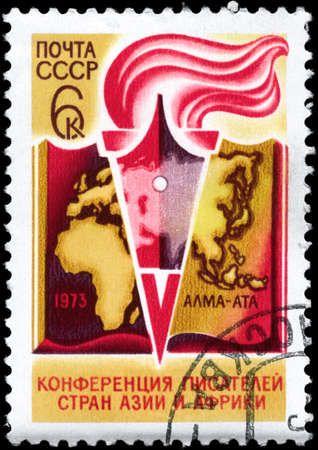 USSR - CIRCA 1973: A Stamp printed in USSR shows the Book, Pen and Torch and devoted to Conf. of Writers of Asia &Africa, Alma-Ata, circa 1973