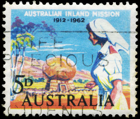 AUSTRALIA - CIRCA 1962: A Stamp printed in AUSTRALIA shows a Nurse and Rev. Flynn&acirc,%uFFFD%uFFFDs Grave, Inland Mission, 50th anniversary, circa 1962