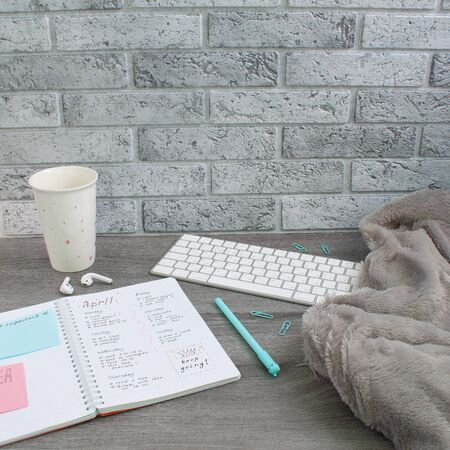 Photo pour Concept layout of work place. Keyboard, planner and a cup - image libre de droit
