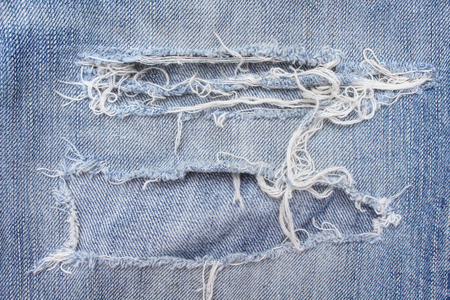 Photo for Texture blue jeans with ripped on background, hole and white threads destroyed patterns on denim - Royalty Free Image