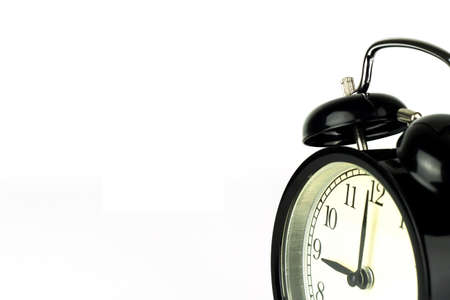 Alarm Clock on white, showing nine o'clock.