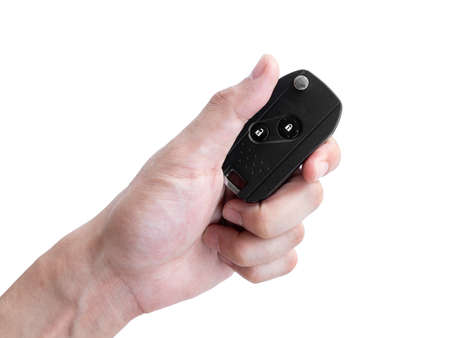 Photo for Man hand holding a car key remote isolated on white background, Clipping path - Royalty Free Image