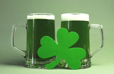 Happy St Patrick s Day two glass steins of green beer and shamrock