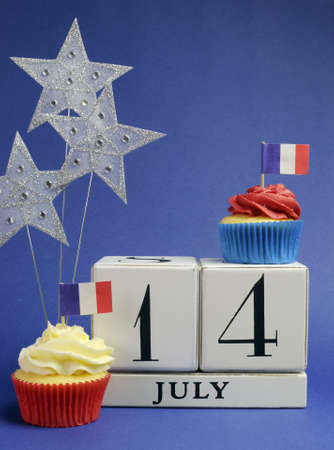 France National holiday calendar, 14 July, Fourteenth of July, Bastille Day, with flags , cakes and stars decorations. Vertical.