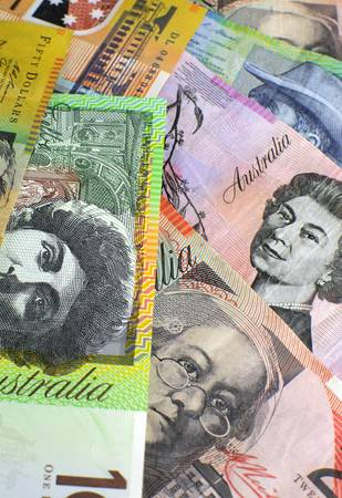 Australian paper money, including one hundred, twenty, ten, five and fifty dollar notes against a black background  Vertical