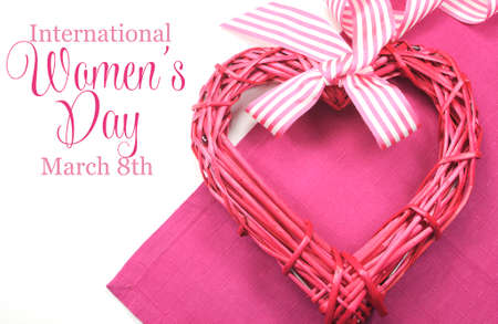Happy International Womens Day, March 8, celebration greeting message with pink rattan cane heart and stripe ribbon
