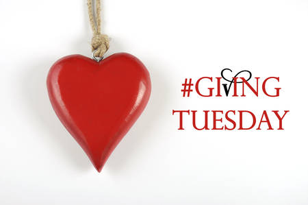 Giving Tuesday philanthropy day after Black Friday shopping message sign with red heart and sample text.