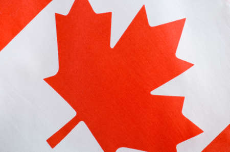 Canadian red and white maple leaf flag for Canada Day, July 1, celebration and national holidays, closeup.