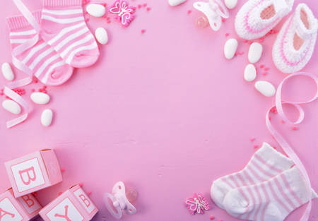 Photo pour Its a Girl pink theme Baby Shower or Nursery background with decorated borders on pink wood background. - image libre de droit
