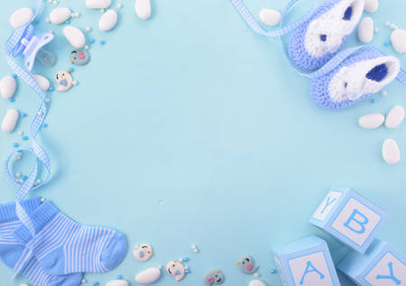 Photo for Its a boy, blue theme Baby Shower or Nursery background with decorated borders on pale blue wood background. - Royalty Free Image