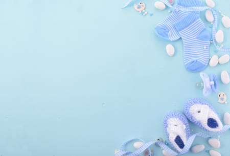 Photo pour Its a boy, blue theme Baby Shower or Nursery background with decorated borders on pale blue wood background. - image libre de droit