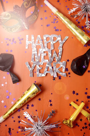 Photo for Happy New Year Party Decorations on dark wood table   with applied filters and lens flare. - Royalty Free Image