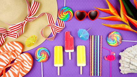 Photo for Summer vacation theme flatlay overhead with sunhat, lollipops, ice creams and sunglasses on purple background. - Royalty Free Image