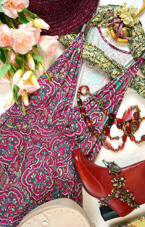 On-trend Boho Chic style fashion layout flat lay with red pink floral summer dress and accessories.の写真素材