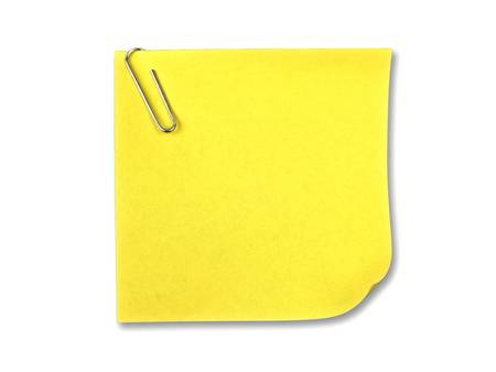 Yellow sticky note with clip on white background