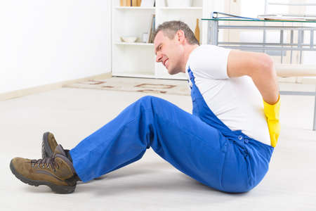 Photo pour Man worker with back injury, concept of accident at work - image libre de droit