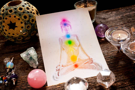 Photo for Chakras illustrated over human body with natural crystals and pendulum - Royalty Free Image