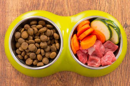Foto de Natural food in a bowl as opposite of dry dog'd food - Imagen libre de derechos