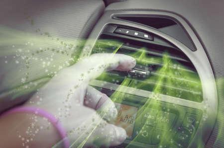 Foto de Driver hand tuning air ventilation grille, dirty air comming out - Imagen libre de derechos