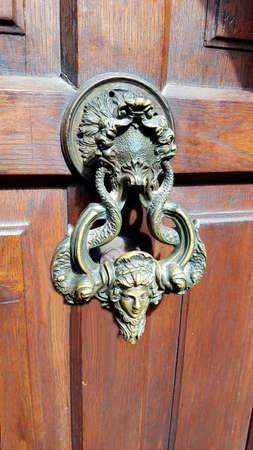 Ancient doorknob on wooden castle door, Romania