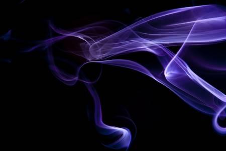 Blue purple smoke flowing horizontally on black background