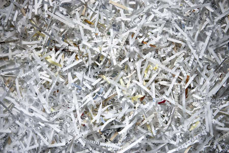 Close up of shredded paper strips in assortment of colors and paper types