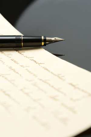 Fountain Pen and Letter with extreme shallow depth of field. Focus on very end of nib on pen.
