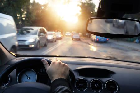 Foto de  Driving car around town in sunny end of a day  - Imagen libre de derechos